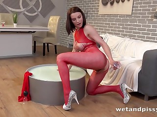 Beauty in red underthings gets off on playing with her piss