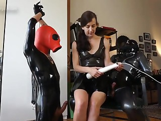 Rubber charm femdom porn video with mistress Elise Graves